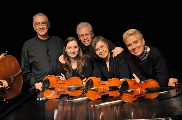 A photo of the five members of Chamber Music Amici with their instruments